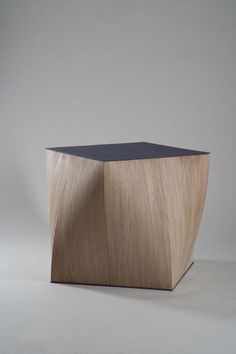 I like the clean, hard, colored geometry of the top in contrast with the more organic twisting and undulating lines of the sides of this stool/table.  Unfortunately, its sharp edges and corners would not make this form a viable option in a home with toddlers or octogenarians. :(  |  table-trunk by Andrey khvorostyanov