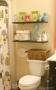 Great shelves for kids' bathroom--love the framed pics of the kids playing in the tub to bring in color and personality