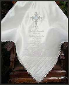 Christening and Baptism blankets and shawls, bibs, albums, gifts.