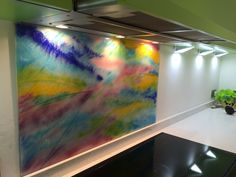 Bespoke, hand made glass splash back behind hob. A vibrant piece using colours evident in the kitchen. Vibrant, Glass Installation, Interior Accessories, Glass, Interior, Glass Kitchen, Splash, Hobs, Colours