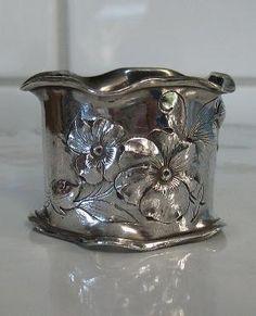 Antique metal napkin ring with pansies
