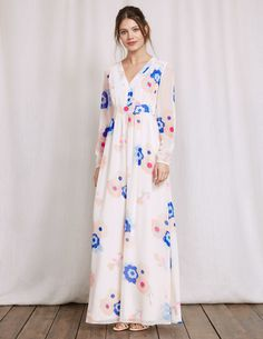 Find your free spirit and run barefoot through the cornfields (or just wow everyone at the garden party) with this floaty maxi dress. The empire line is flattering and creates a feminine shape. A stunning floral print and lace detail complete the Seventies feel.