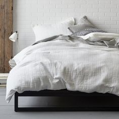 domino By The Company Store® Vernon Duvet Cover / Sham - Think texture. Relaxed and casual, the Vernon Duvet Cover is distinguished by its intentionally rumpled texture. Offered in four neutral hues, its face is sewn of organic cotton and the reverse is cotton percale, that's been washed for lived-in softness.