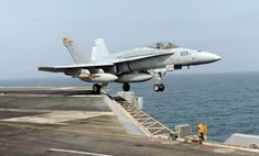 ARABIAN SEA (Sept. 17, 2010) An F/A-18C Hornet assigned to the Checkerboards of Marine Fighter Attack Squadron (VMFA) 312 launches from the aircraft carrier USS Harry S. Truman (CVN 75). VMFA-312 is deployed as part of the Harry S. Truman Carrier Strike Group supporting maritime security operations and theater security cooperation efforts in the U.S. 5th Fleet area of responsibility. (U.S. Navy photo by Mass Communication Specialist Seaman Apprentice Tyler Caswell/Released)