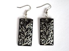Expressive rectangular #earrings made of wood with a #handpainted look smart and stylish. Used for drawing stylized Ukrainian folk #painting. Decorated with Silver contour pattern. Size rectangles 3,7* 1.8 cm. (1,5* 0,7 inches), Weight pair just a few grams. Painted with acrylic paint and securely covered with a protective varnish. Medical steel fittings.