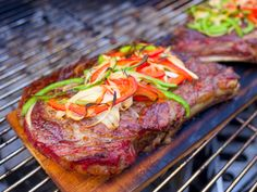 Cedar Plank Grilled Ribeye with Peppers and Onions