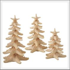 Starfish Christmas Trees. Bumpy starfish inspired the creation of this unique beach Christmas tree. Stacked starfish in varied widths create a traditional Christmas tree shape, but in a beach Christmas style. Gather on the mantel or tabletop to add a warm, coastal style to your Christmas.