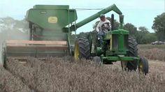 John Deere tractor and John Deere pull-type combine.