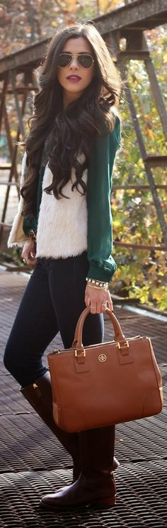 White faux fur vest, green blouse, skinnies and long tan boots with brown handbag