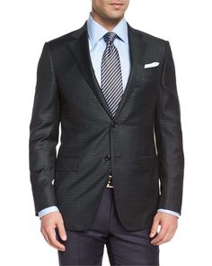 Ermenegildo Zegna check sport jacket. Notch lapel; two-button front. Lightly padded shoulder. Basted sleeves. Front flap pockets; chest welt pocket. Double vented back. Wool. Made in Switzerland of It