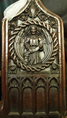 East Brent St Mary: 15th-century benchend depicting a pelican in her ...