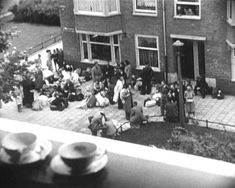 June 1943. Jewish citizens gather at an assembly point in the Lekstraat in Amsterdam-Zuid. From here they were transported to the Muiderpoortstation and then by train to transition camp Westerbork and concentration camps. #worldwar2 #1943 #Lekstraat