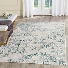 Artifact Blue/Cream (Blue/Ivory) 6 ft. 7 in. x 9 ft. 2 in. Area Rug