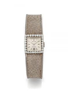 ROLEX N° 62/364, vers 1960 Montre bracelet de dame en or blanc 18K (750). Boitier carré. Lunet