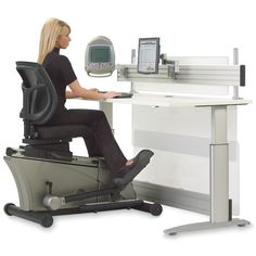 The Elliptical Machine Office Desk. This is the adjustable-height desk that pairs with a semi-recumbent elliptical trainer to let users exercise while on the job.for people with a sit down at the desk all day type of job! Gadgets And Gizmos, Cool Gadgets, Kids Gadgets, Baby Gadgets, Cooking Gadgets, Tech Gadgets, Kitchen Gadgets, Home Office, Office Desks