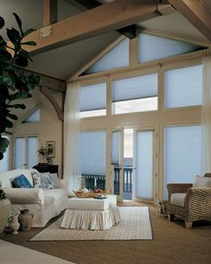 Hunter Douglas Duette honeycomb cellular shades installed in triangular shaped windows.
