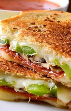 pepperoni pizza toppings in a grilled cheese, serve marinara or tomato soup on…