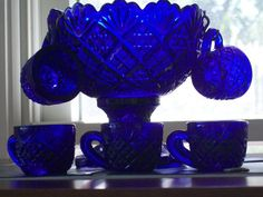 Vintage cobalt blue childs punch bowl set with six cups.bowl is high.deep blue color and has a faux cut glass look.cups have the letter R in a shield in the center of each cup Cobalt Glass, Cobalt Blue, Blue Dishes, Antique Glass, Antique China, Punch Bowl Set, Himmelblau, Carnival Glass, Vintage Glassware