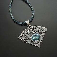 Treasure Of The Lake  Treasure Of The Lake | Silver & Aqua Aura Crystal Pendant Necklace - product images  of SCHJ  www.silverchamber...