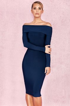 017726c3b1 The deep midnight blue colour is a perfect substitute for black and the  deep off shoulder cut is set off by the long sleeves.