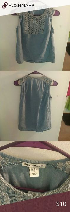 Sleeveless Blouse Chambray sleeveless blouse that's been gently used. No signs of wear or stains. Size xsmall dalia collection   Tops Blouses