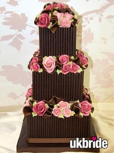 Lindy would do round tiers and cream/white roses and twigs for natural looking theme