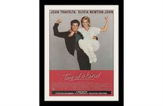 "An original 1984 movie advertisement for ""Two of a Kind"". Photo ad print featuring John Travolta and Olivia Newton-John. ""Twentieth Century Fox Presents a Joe Wizan Production. A John Herzfeld Film Jo"