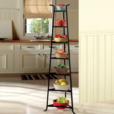 This unique triangular-shaped rack provides storage for seven bowls or baskets using minimal space.  Fill the bowls with fruits or plants to decorate your home  http://eileenhraha.athome.com/shelves-_-hooks/manor-house-seven-tier-bowl-rack.html
