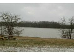 4994 Brust Drive, Powell, OH 43065 — LOCATION LOCATION LOCATION, Wooded scenic setting on 2 parcels (#31923002042000 and #31923002043000) on .93 acres. Totally remodeled hillside ranch borders meadow on Scioto Reserve CC hole #5. View wildlife from decks or screened porch. Gourmet custom kitchen by Jae with island, tile floor, double oven, 3 sinks. Great room with stone WBFP, beamed ceiling. Wood floors (under carpet) in bedrooms and great room. Dining room is currently the study. Large ...