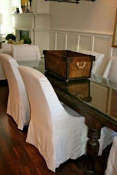 slipcovers are the most fantastic and the most economical way to give your home a quick facelift.  Always go white!