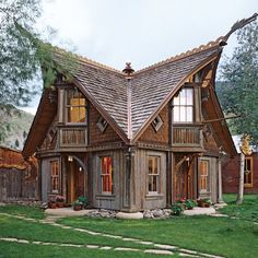 """Architectural Digest: Drawing on Norwegian stave church architecture, a boathouse built over six years in Creede, Colorado, """"was a work in progress the whole time,"""" recalls designer and builder Bryan Anderson. Ideas De Cabina, Viking House, Viking Life, Storybook Cottage, Church Architecture, Sustainable Architecture, Modern Architecture, Scandinavian Architecture, Residential Architecture"""