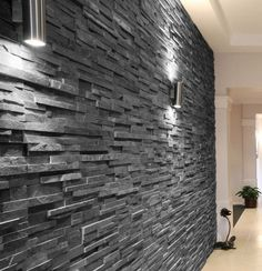 Slate Black Split Face 15x60 wall tile. An interlocking natural stone tile of black slate with a matt finish and riven texture.