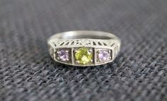 A lovely vintage sterling silver peridot and amethyst ring, this is a very beautiful piece of jewellery. Vintage ring - vintage sterling silver ring
