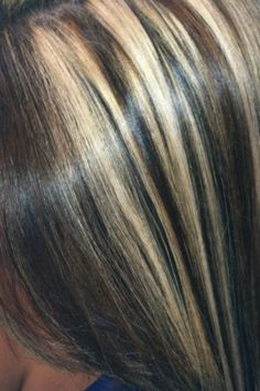 Blonde and caramel highlights dark brown base