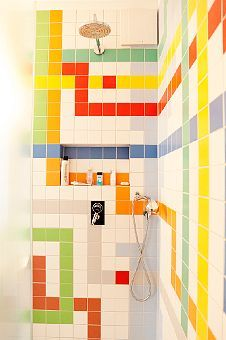 Colorful kids bath. Love the whole idea of this for a bathroom. Wonder if I can paint the white tile in my guest room to match. The shower curtain I use is a map of the London Underground.  These designs would work beautiful together. Anyone work with tile paint?