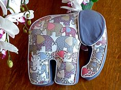 Love that the elephant pillow is made of elephant fabric. And his eye covering ears! And the piping! Just adorable.