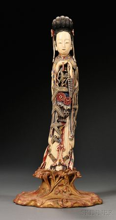 Large Polychrome Painted Ivory Carving, China, depicting the standing figure of a lady holding a basket of flowers, (drilled), ht. 18 3/4 in