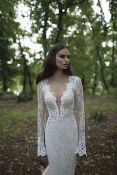 The plunge down the front of this dress is too dramatic for my taste, but the lace and sleeves are exquisite.