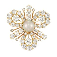 Antique Gold, Natural Pearl and Diamond Pendant-Brooch, Tiffany & Co.  The clover-shaped brooch centering one pearl approximately 6.94 mm., set with 42 old-mine cut diamonds approximately 3.15 cts., signed Tiffany & Co., circa 1900, approximately 6.3 dwts.