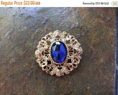 August Sales Gold tone filigree open work brooch or pin by EMTWTT