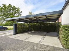 Steeldeck carport with flat roof Privet hedge softens the industrial look and provides privacy. Metal Barn Homes, Metal Building Homes, Pole Barn Homes, Building A House, Car Porch Design, Garage Design, Carport Garage, Pergola Carport, Gazebo