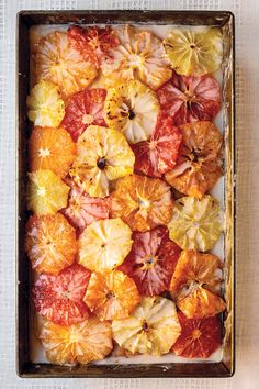 Broiled, sugared grapefruit slices and a citrus glaze top this moist cake scented with zest...dessert!