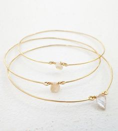 Gold Pearl Bangle Bracelets - Set of 3 | These delicate bangle bracelets are handcrafted from hammered ... | Bracelets