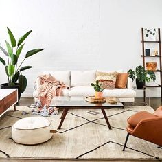 This room has the perfect amount of greenery with gorgeous tan and wood accents