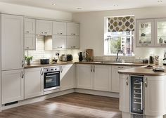 The soft cashmere colour of our Burford Shaker matt kitchen is a great alternative to cream, maintaining a light & airy feel. See more at Howdens.