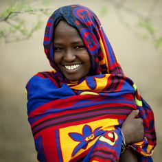 Veiled Karrayu girl smiling, Ethiopia