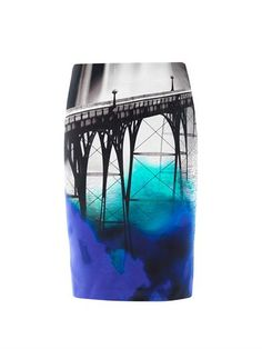 STYLE NOTES Mary Katrantzou takes her eye-catching style in an urban direction with this San Francisco skirt. The black and white landscape image is modernised with a vivacious splash of colour. Team yours with a crisp white shirt for a statement look.