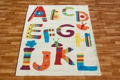 Biały dywan dla chłopca i dziewczynki z alfabetem
