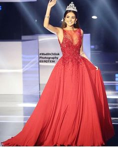 Moments before crowning this year's beauty queen, @misslebofficial 2015 & Miss world runner up, @valerieabouchacra glided down the stage like she just stepped out of a fairy tale scene in a flaming red chiffon princess #Couture gown showered in red @swarovski crystals at the bodice & the waistline  #MissLebanon #ZuhairMurad #HauteCouture #lbci