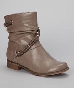 These boots may have a low profile, but they're definitely high fashion. A hint of slouch and braided accents make this pair of footwear fun and funky.